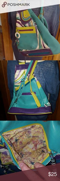 """Cute Mystere Backpack/Purse Very colorful leather purse that converts to a backpack. Don't be fooled by the small size --- this cute bag has multiple spots and slots that hold a great deal. I really pack a purse and surprised that this gem holds most that I carry with me.  Triangular shape: 13 1/2"""" top to bottom; 24"""" straps.  Purchased in the Mystere shop in Las Vegas!! Awesome show! Bags Backpacks"""