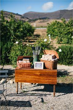 love is sweet have smores table with smores favor boxes #weddingfavors #smoresdiy #weddingchicks http://www.weddingchicks.com/2014/03/26/rustic-romance-wedding/
