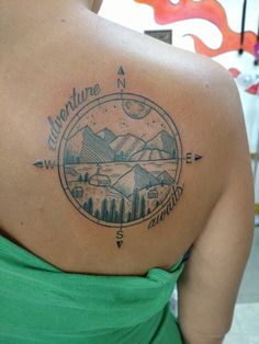 Adventure awaits compass tattoo with mountains
