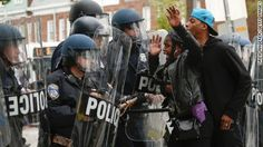 Defiant protesters squared off with police in some parts of Baltimore well after a citywide curfew went into effect Tuesday night.   An informative report on current events occurring in Baltimore, United States due to police brutality accusations