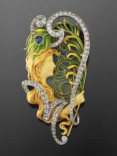 Art Nouveau Diamond and Enamel Maiden and Peacock Feather Brooch by Louis Aucoc. A diamond-set scroll with a total of approximately 2.20 carats frames an enameled maiden holding a peacock feather against a plique a jour enamel background, set in 18 karat yellow gold and platinum.