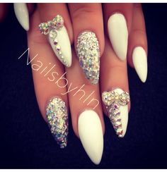 White and sequin stiletto nails. Love the bows
