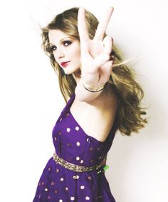 Taylor in a purple (fav. color) and polka dot dress.