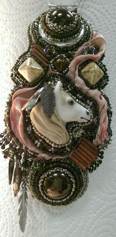 Laura Mears pony on a Shibori ribbon and Czech focal embellished pendant.