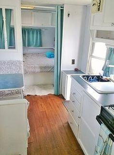 Thor travel trailer redo aqua, grey and white.