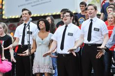 The Book of Mormon cast members (L-R) Andrew Rannells, Nikki M. James, Josh Gad, and Rory O'Malley attend the Broadway Unites: 9/11 Day of Service and Remembrance ceremony at Times Square on September 9, 2011 in New York City. (Photo by D Dipasupil/Getty Images for The Broadway League)
