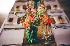Orange blooms in aqua mason jars | Read More - http://onefabday.com/rustic-chic-french-vineyard-wedding/