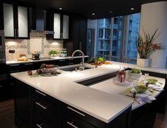 Beautiful espresso cabinets with white granite countertops. by victoria