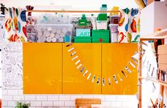 Hide storage above kitchen cabinets by hanging a rod from the ceiling and adding a curtain
