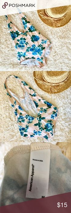 American Apparel Bodysuit Festival season is almost here! Gear up with this flirty & floral halter bodysuit by American Apparel. I don't think American Apparel makes these anymore.   This super duper stretchy bodysuit is labeled as a size M, but could for sure fit a S as well– American Apparel can run small in my opinion. Pairs well with high rise jeans or a circle skirt! Tops Tank Tops