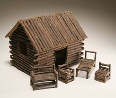 Folk Art twig log cabin dollhouse with angled hinged roof and furniture