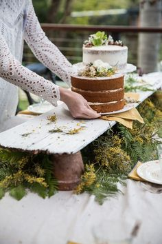 Cool way to do a dessert table...raised up with greens underneath