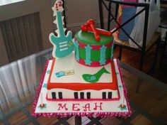 I like the idea of using this cake for a template and having a layer of piano, one layer drum and the top with a guitar.  Also like the color scheme. @Lyndsey Chamberlain Foster