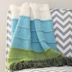 This Knit Multi Colored Blanket is a simple yet beautiful pattern that will make a snuggly, colorful afghan. Free pattern included.