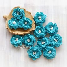 Handmade flowers by Anjurisa. We love fabric flowers because they will never wilt.