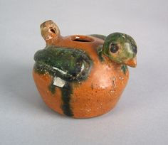 """Realized Price: $ 4446   Pennsylvania redware bird whistle dated 1797, with green glazed head and wings, 2 3/4"""" h. Provenance: Titus Geesey."""