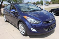 2013 Hyundai Elantra Limited Sedan in Indigo Night.  The Elantra Limited is loaded with features like a standard power moonroof, power driver seat, heated front & rear seats and leather interior, just to name a few.