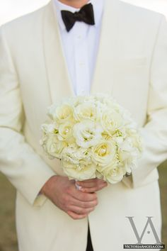 pale yellow/cream tux or jacket with matching brides bouquet