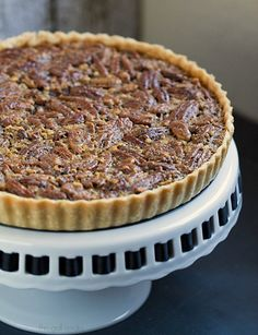 This Classic Pecan Pie Tart is spiced up with cinnamon, spiced rum and is a perfect dessert for friends and family that enjoy traditional holiday desserts. Holiday Desserts, Holiday Baking, Just Desserts, Delicious Desserts, Pecan Pie Tarts Recipe, Pecan Pies, Tart Recipes, Baking Recipes, Pie Dessert