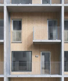 Tappen / Joliark | Metal-clad housing featuring flush detailing and boxy balconies.