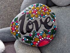 Hey, I found this really awesome Etsy listing at https://www.etsy.com/listing/164967313/love-is-the-answer-painted-rock-sandi