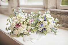 Image by Sarah Jane Ethan - Classic Wedding At Ellingham Hall In Northumberland With Bride In Madeline Gardner Dress And Bridesmaids In Different Pastel Coloured Dresses With Groom And Groomsmen In Grey Suits From Next With Homemade Hydrangea Flower Arrangements