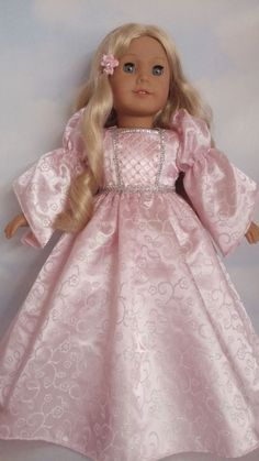 This Gorgeous Gown will fit the American Girl Doll. Fabric is Light Pink Satin covered with a Glittery Floral Print Embellishment is Silver Trim on the Bodice and Waist All Seams are Surged for a Professional Look on the Inside. Bodice is Fully Lined for a Professional Look at the Neck Sleeves have Elastic around the Upper Arm Closes in the Back with and INVISIBLE Zipper. This Gown is Designed and Custom Sewn by Me. Made in USA - Smoke Free Home