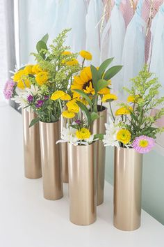 """7 creative uses for pvc pipe. I like these metallic-painted """"vases."""""""