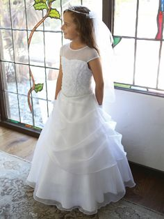 Stunning First Communion Dress with draped organza skirt. This White First Communion Dress features an embroidered illusion neckline. Buy First Holy Communion Attire at our First Holy Communion Stores Online Gowns For Girls, Dresses For Sale, Girls Dresses, Dresses Dresses, Casual Dresses, Sequin Flower Girl Dress, Flower Girl Dresses, Flower Girls, Stunning Dresses