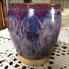 Coyote glaze blue purple over Amaco potters choice smokey Merlot with a little indigo float.