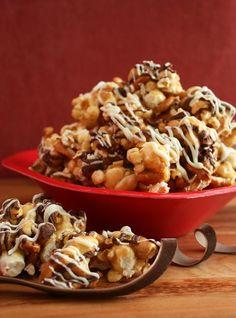 Fancy Caramel Popcorn (pretzels + nuts + popcorn + caramel + milk &  white chocolate). Sounds SO good.