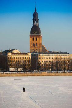 Frozen river Daugava, Dome church, Riga.