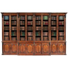 For Sale on - An important mahogany library bookcase firmly attributed to Gillows. Of outstanding quality; of breakfront form, rising from a plinth base; the lower part