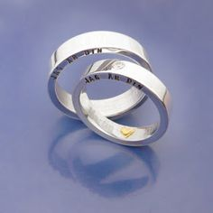 Personal weddingrings. Handmade, silver, 18ct gold and a white, glimmering stone.
