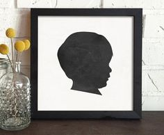 personalized child silhouette portrait. Based on a traditional black and white silhouette. This custom portrait is done in a soft, slightly faded