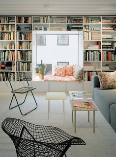 Love the window seat in the middle of the book shelf. This is how I picture the attic library we will have someday, except it will be a tree tops view from the window.