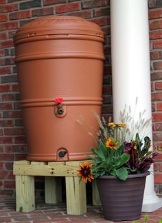 Thinking about building your own rain barrel to save on your water bill? DIY rain barrels have become an extremely popular way to collect rainwater Rain Barrel Stand Diy, Rain Barrel Kit, Rain Water Barrel, Rain Barrels, Goat House, Tank Stand, Country Chic Cottage, Garden Crafts, Backyard Landscaping