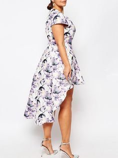 35d4e9b6060b 13 Plus-Size Guest Dresses to Wear to a Summer Wedding - High-Low from  InStyle.com