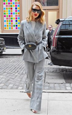 ROSIE HUNTINGTON-WHITELEY wearing a gray plaid pantsuit, a black Gucci fanny pack and clear sandals in N.Y.C. - March 2018