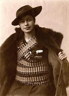 """Finland, 1918: Verna Erikson, one of the few women students at the University of Technology, was in the """"Whites"""" party (versus the communist """"Reds"""") in the country's brief but bloody civil war. With women friends, she smuggled arms for the Whites. Here, she posed with a gun and 1,350 rounds of ammunition, about to smuggle them across the city under her fashionable coat. Within the year, she had been awarded the Order of the Cross of Liberty, and had died of breast cancer. Click for her story."""