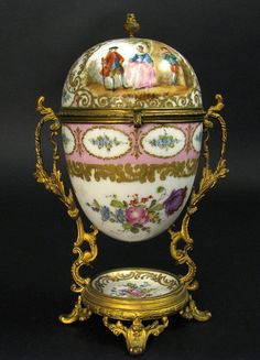 French ormolu-mounted painted porcelain egg-form box