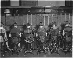 Chesapeake and Potomac Telephone Company. View of row of operators. View of chairs showing type of chairs used by telephone company. 04/07/1927