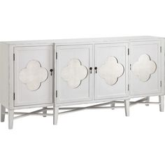 Showcasing mirrored quatrefoil door fronts and a stretcher base, this eye-catching sideboard is perfect anchored in your dining room as a glamorous home bar....