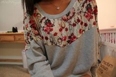 Take a plain old sweatshirt and add a fabric of your choice. I need to do this.