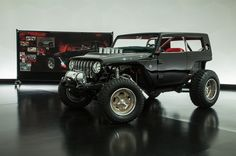 """AUBURN HILLS, Michigan – Design chief Mark Allen calls them the """"Spy vs. Spy"""" of the 51st Annual Moab Easter Jeep Safari concepts. The chopped black Jeep Quicksand sports a 392 cubic-inch Hemi under what's left of its hood, and it's designed for kicking up sand, quickly, with all four wheels, as a sort of..."""