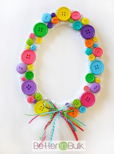 Spring Easter Egg Button Wreath - a simple spring time craft that is easy enough for kids to make and cute enough to display on the walls!