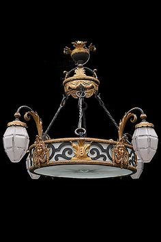 French Antique Gilt and Patinated Wrought Iron Regence-Style 4-Arm Chandelier