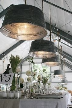 Galvanized buckets as pendant lights.Would be great in the kitchen, for a barn wedding or a covered porch. Paint the inside gold for that Industrial Chic look.
