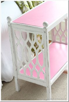 You never know what you're going to find at your local Goodwill of East Texas like this side table that was re-furnished with white and pink paint!