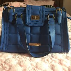 Navy blue handbag The bag been used. Has some marks inside and black marks on the bottom , But still in good conditions. Taking offers Catherine Malandrino Bags